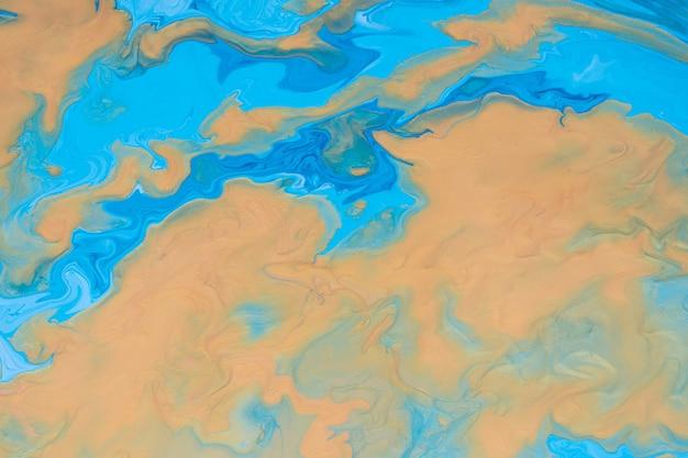 Абстрактное жидкое искусство. свободно текущая золотая и синяя краска. мраморный фон или текстура.