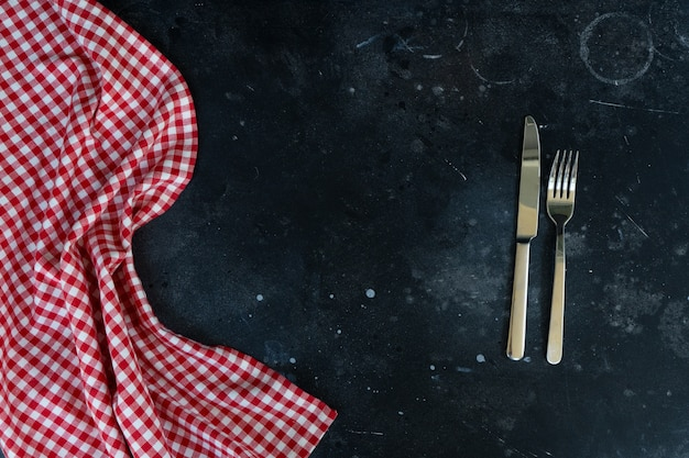Abstract food background with napkin and cutlery