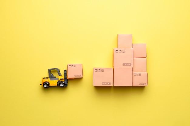 パッケージ商品をロードするための抽象的なフォークリフト