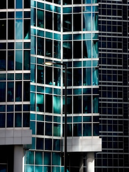 Abstract fragment of modern architecture, walls made of glass.