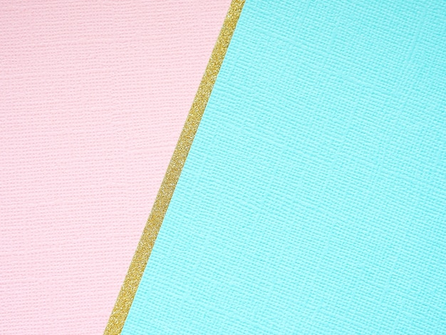 Abstract geometric background of gold, blue and pink paper.
