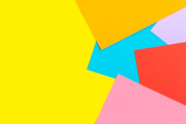 Abstract geometric  of colored paper - yellow, red, blue, orange, lilac colors flat lay top view mock  up