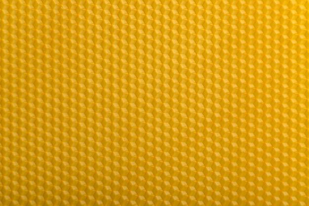 抽象的な幾何学的なイラスト。黄色のシームレスな背景。
