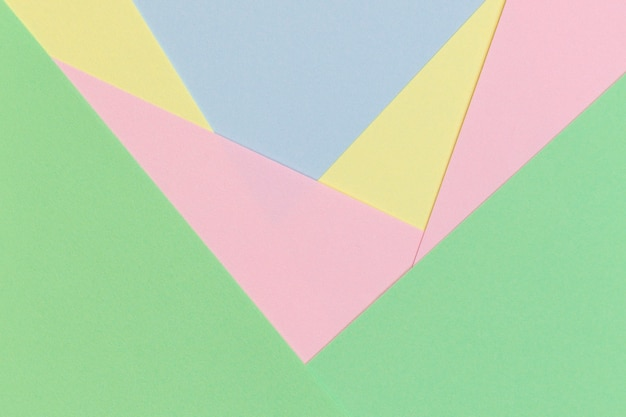 明るいパステルカラーの色調の抽象的な幾何学的な紙の背景