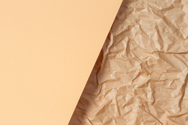 Abstract geometric paper texture background blank beige color paper sheet over recycle crumpled brown paper background