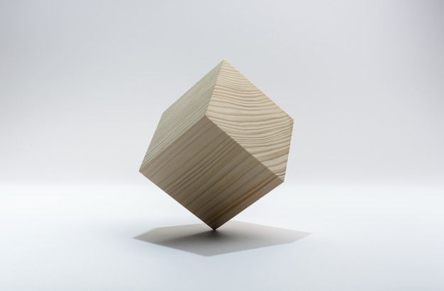 Abstract geometric real wooden cube on white background