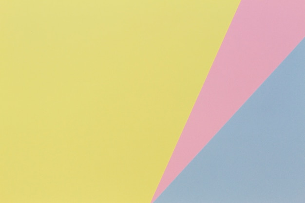 Abstract geometric shape pastel blue, pink and yellow color paper background