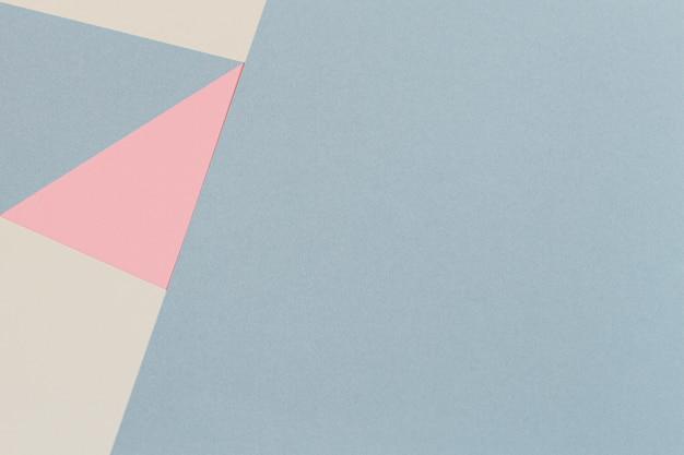 Абстрактная геометрическая предпосылка текстуры бумаги пастельного цвета моды. вид сверху, плоская планировка