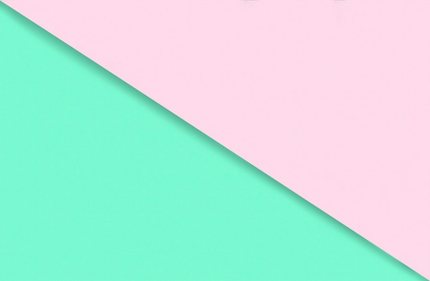 Abstract geometric water color paper background in soft pastel pink and green trend colors with diag...