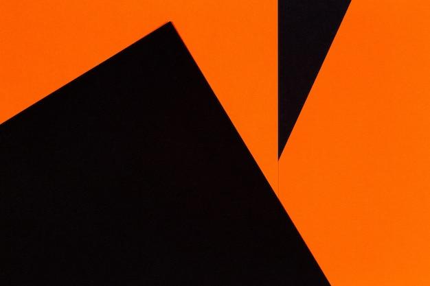 抽象的な幾何学紙テクスチャ背景。黒とオレンジ色の形と線。上面図
