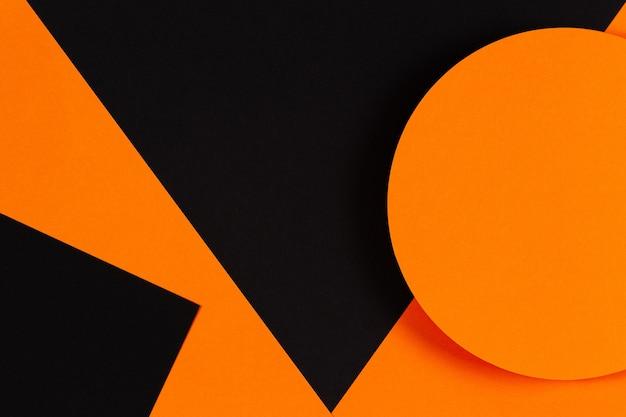 추상적 인 기하학 종이 질감 배경. 검정색과 주황색의 모양과 선. 평면도