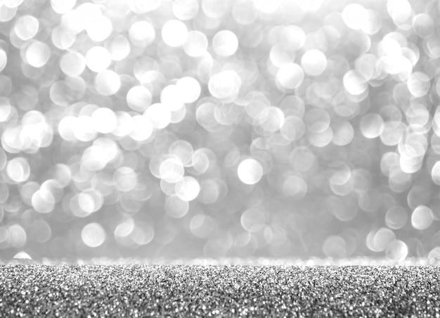 抽象的なキラキラ銀背景。休日の光沢のある質感。冬のクリスマスのテーマ