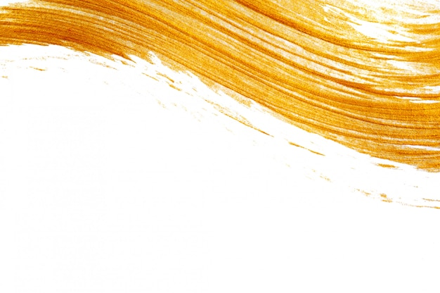 Abstract gold acrylic paint brush with place for text