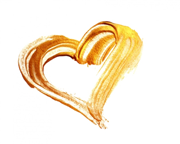 Abstract gold heart with acrylic paint brush on white background