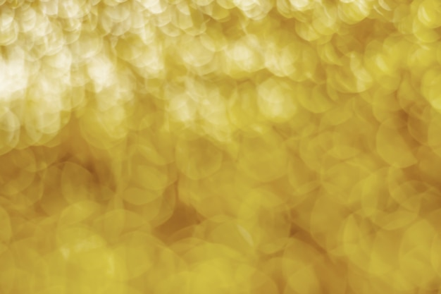 Abstract gold light bokeh christmas light blurred background
