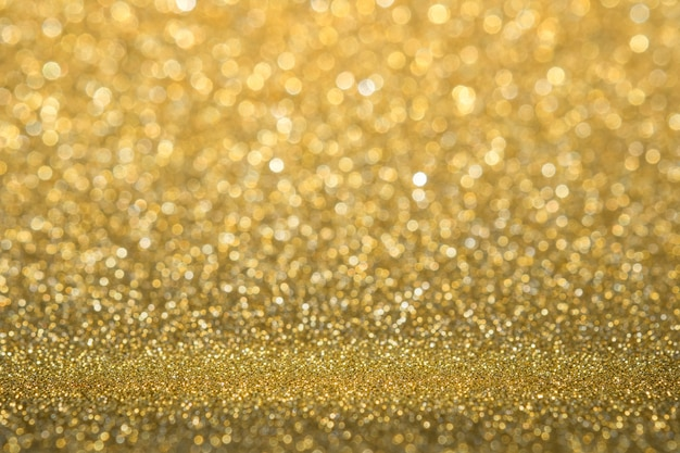 Abstract gold sparkling glitter wall and floor perspective background studio with blur bokeh