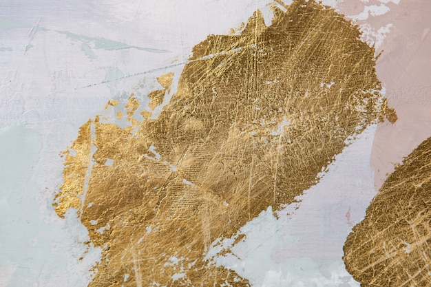 Abstract gold texture. decorative painting of walls colored with gray and golden plaster.