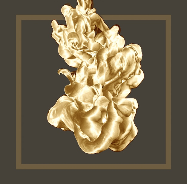 Abstract golden ink drop on clear background with frame.
