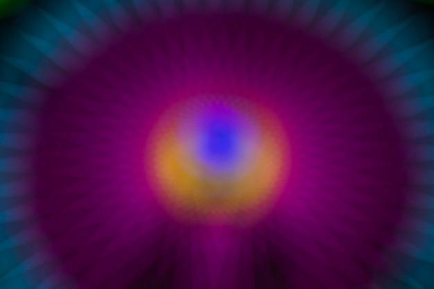 Luci al neon viola movimento offuscata sfumatura astratta di una ruota di meraviglia