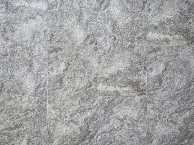 抽象的な灰色の石のタイル壁のシームレスなテクスチャ背景。