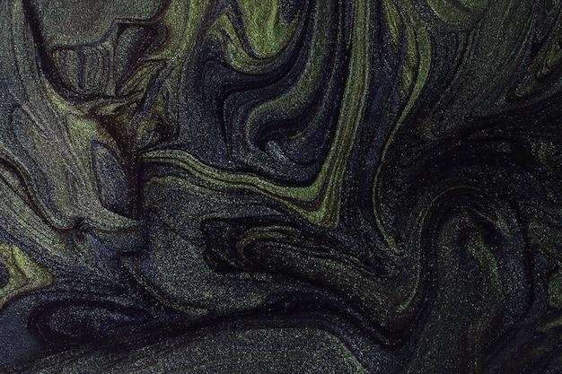 Абстрактный зеленый и темно-синий мерцающий фон. макияж концепции. красивые пятна жидких лаков для ногтей. жидкое искусство, техника заливки. хорошо подходит для размещения текста или логотипа.