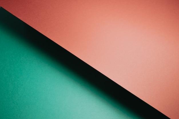 추상 녹색 및 주황색 용지 형상 구성 배경, 최소한의 그림자, 복사 공간. 최소한의 기하학적 모양. 화려한 배경 개념