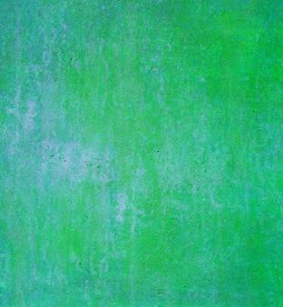 Абстрактный зеленый фон с винтажной гранж фоновой текстуры зеленой бумаги