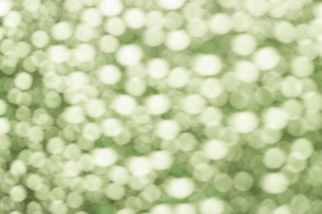 Abstract green blurred bokeh from water drops