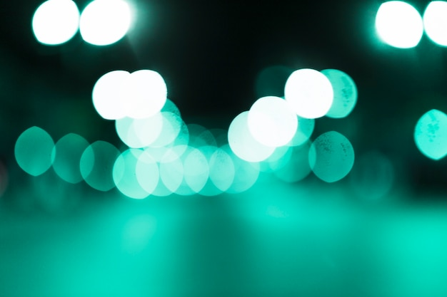 Abstract green bokeh illuminated background