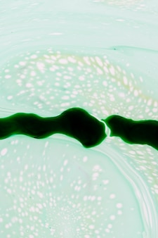 Abstract green light slime in oil