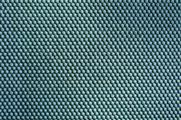 Abstract green metal background. iron dots texture on outdoor metal wall.
