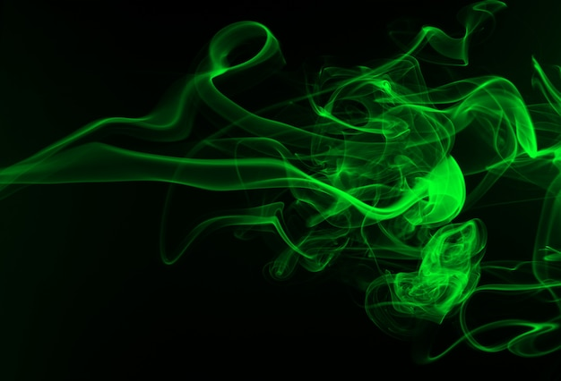 Abstract green smoke on black background, darkness concept