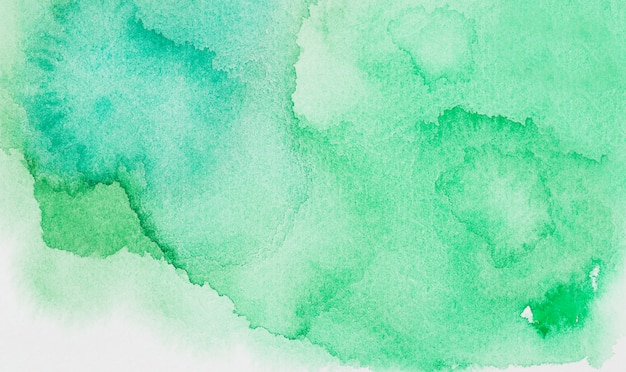 Abstract green spots of paints on white paper