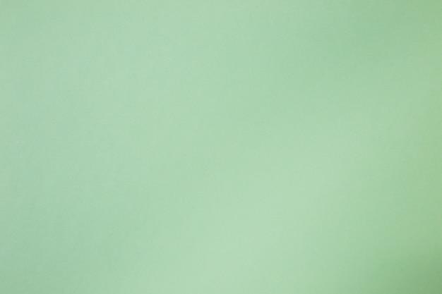 抽象的な緑色のトレンドは、紙の背景色。コピー空間の概念またはアイデア画像の使用
