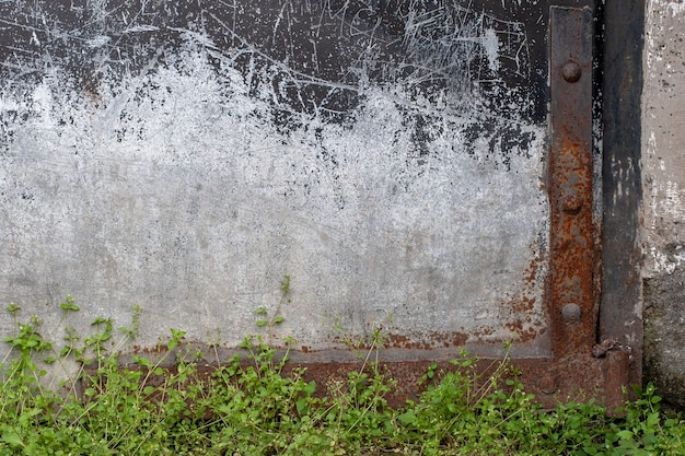 Abstract grunge background. the lower right side of the old garage door. scratches and rust.