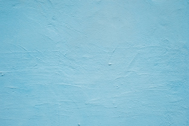 Abstract grunge decorative blue plaster wall background with winter pattern.