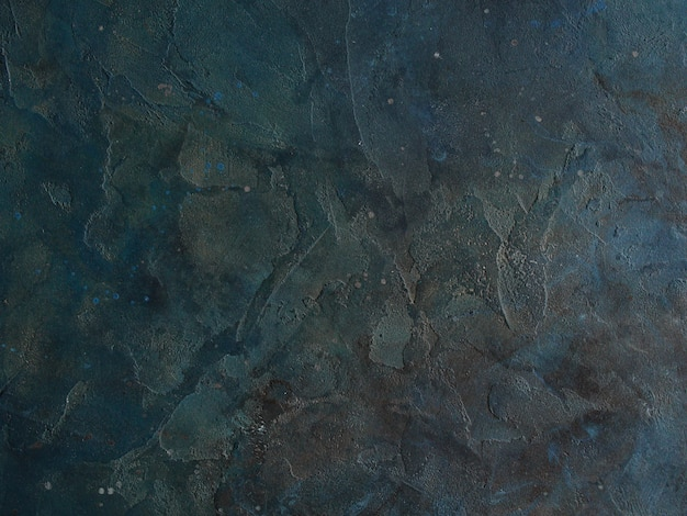 Abstract grunge decorative dark blue grey stucco wall background. gloomy rough smear texture.