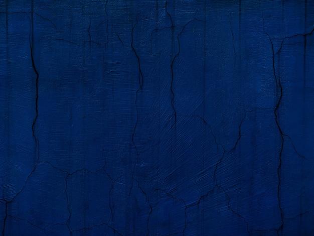 Абстрактный гранж декоративный темно-синий фон стены штукатуркой