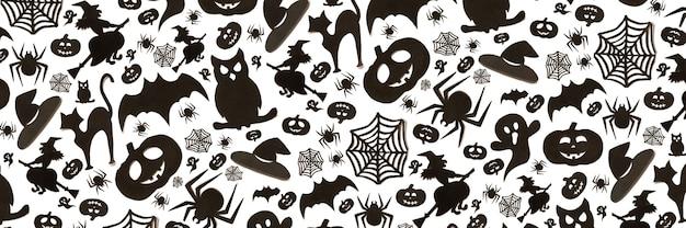 흰색 바탕에 만화 스타일에 추상 할로윈 패턴입니다. 종이 예술. 해피 할로윈 휴일 개념입니다. 배너.