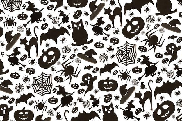 흰색 바탕에 만화 스타일에 추상 할로윈 패턴입니다. 종이 예술. 해피 할로윈 휴일 개념입니다.