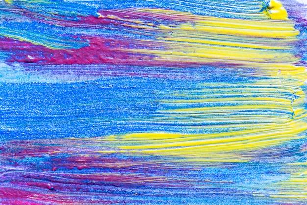 抽象的な手描きのアクリル画の創造的な芸術の背景。ブラシストロークのクローズアップショットは、色のテクスチャのブラシストロークのオーバーラップでキャンバスにカラフルなアクリル絵の具。現代コンテンポラリーアート。
