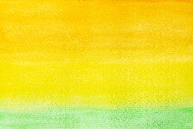 Абстрактная ручная роспись оранжевого, желтого и зеленого акварельного фона текстуры