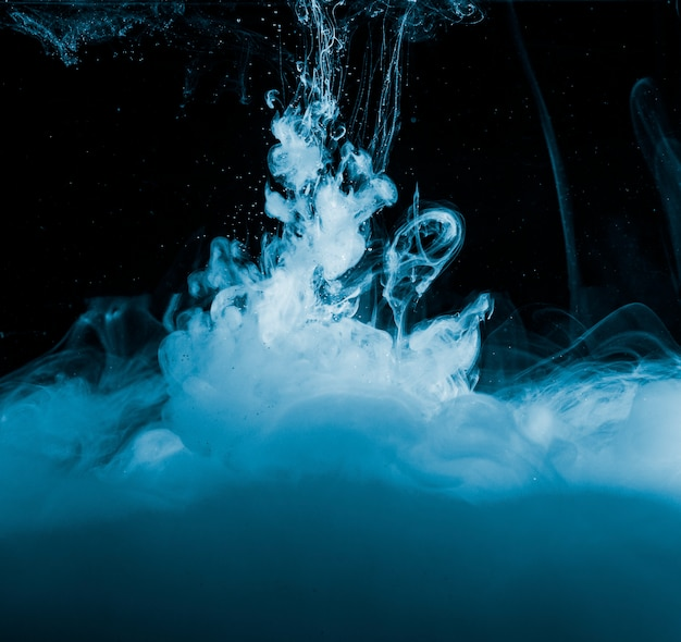 Abstract heavy blue haze in dark liquid