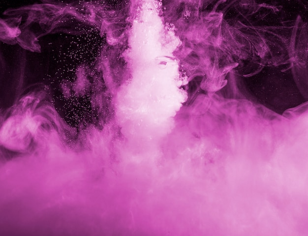 Abstract heavy purple cloud of haze in darkness