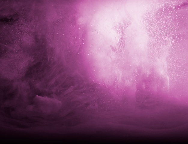 Abstract heavy purple smoke in dark liquid