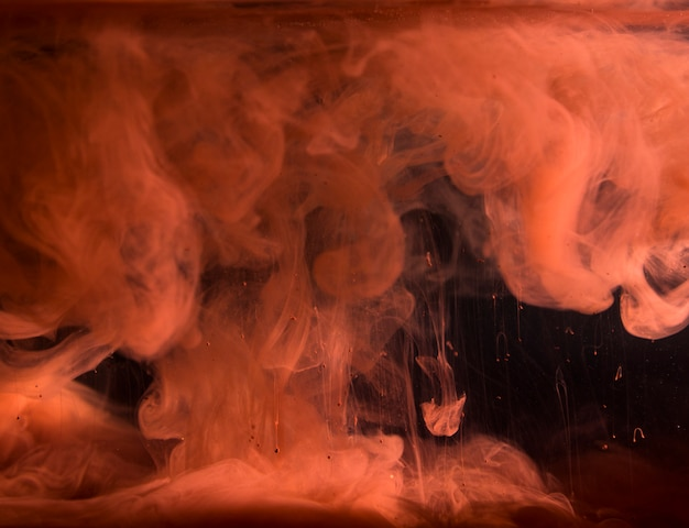 Abstract heavy red smoke in dark liquid