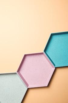 抽象的な六角形の幾何学的なカラフルな背景。パステルカラーのミニマリズム。スペースバナーをコピーする