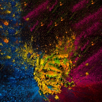 Abstract holi powder spotted over black surface
