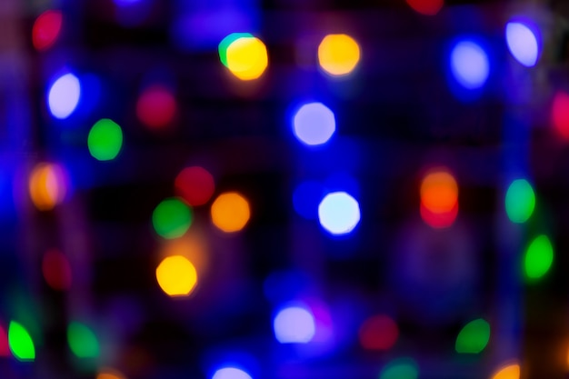 Abstract holiday background. blurred spots of colored lightes