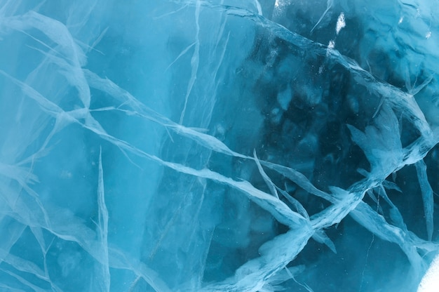 Abstract ice texture. a network of cracks on a piece of blue ice